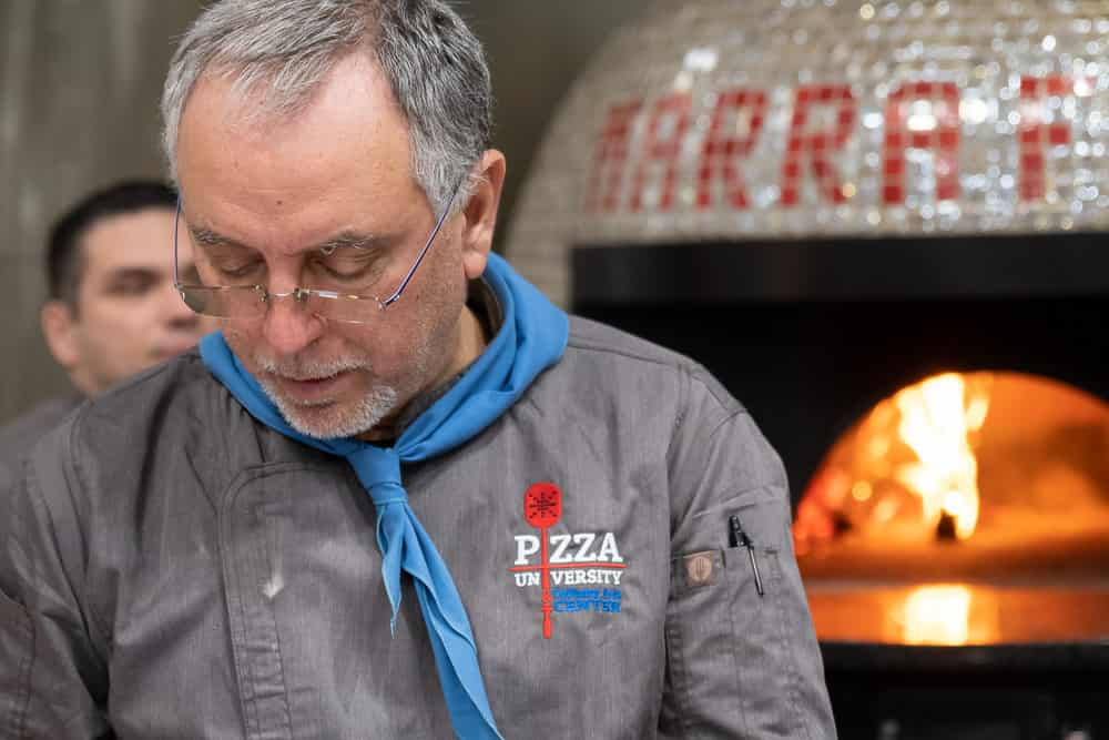 Italian Pizza Chef in front of Marra Forni wood fired oven